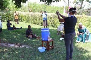 The Water Project: Shihingo Community, Mangweli Spring -  Handwashing Demonstration