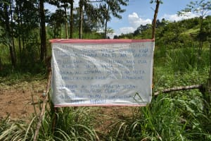 The Water Project: Mukoko Community, Mshimuli Spring -  Sign Left At The Spring Reminding Of Handwashing
