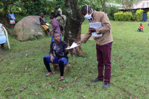 The Water Project: Irungu Community, Irungu Spring -  Issuance Of Pamphlets With Covid Information