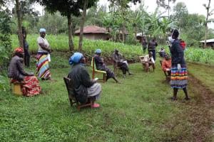 The Water Project: Wanzuma Community, Wanzuma Spring -  Trainer Shigali Listens To A Question
