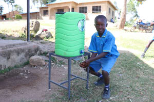 The Water Project: St. Michael Mukongolo Primary School -  A Boy Using The Handwashing Station