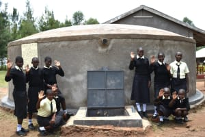 The Water Project: St. Gerald Mayuge Secondary School -  Girls Posing At The Rain Tank