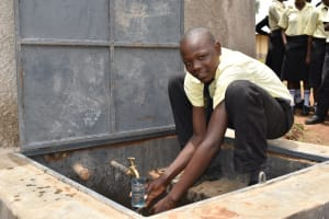 The Water Project: St. Gerald Mayuge Secondary School -  Collecting A Fresh Drink