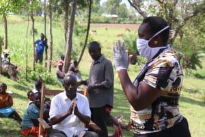 The Water Project: Sambaka Community, Sambaka Spring -  The New Gesture To Replace A Handshake