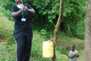 The Water Project: Mungakha Community, Nyanje Spring -  Emmah Leads Handwashing Session