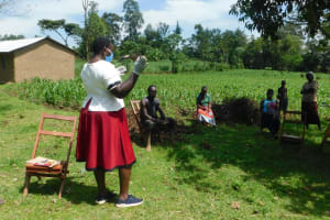 The Water Project: Ataku Community, Ngache Spring -  Team Leader Emmah In Ppe Leads The Session
