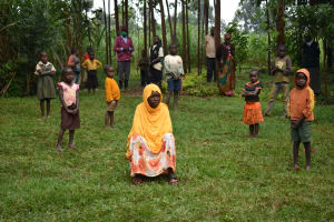 The Water Project: Namarambi Community, Iddi Spring -  Social Distanced Participants At The Training Brave The Rain
