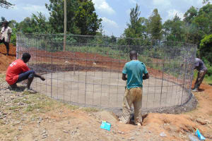The Water Project: Kapsaoi Primary School -  Installing Skeleton Wire Over Concrete Foundation