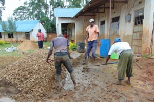 The Water Project: Jinjini Friends Primary School -  Laborers Helping To Mix Concrete