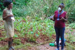 The Water Project: Shitaho Community, Mwikholo Spring -  Facilitator Explaining Coronavirus Symptoms