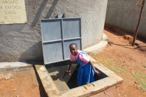 The Water Project: Kapsaoi Primary School -  Pupil Closing Tap