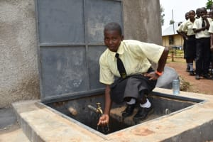 The Water Project: St. Gerald Mayuge Secondary School -  Enjoying Water From The Rain Tank