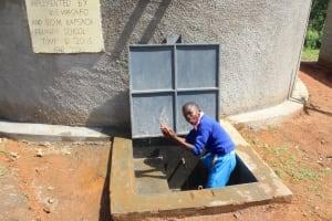 The Water Project: Kapsaoi Primary School -  Pupil Splashing Water