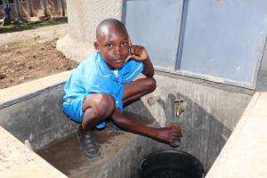 The Water Project: St. Michael Mukongolo Primary School -  Striking A Pose While Getting A Drink