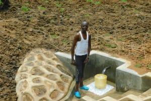 The Water Project: Shikangania Community, Abungana Spring -  Smiles Fetching Water