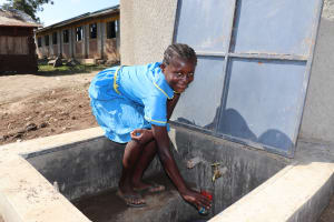 The Water Project: St. Michael Mukongolo Primary School -  Smiles While Easily Drawing Water To Drink