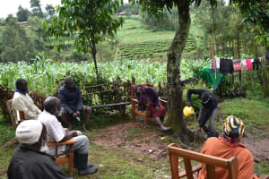 The Water Project: Maganyi Community, Bebei Spring -  Sir Erick Demonstrating How A Tippy Tap Would Work