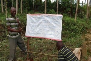 The Water Project: Elukuto Community, Isa Spring -  Installed Caution Chart At The Spring