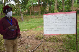 The Water Project: Bukhakunga Community, Ngovilo Spring -  The Facilitaor Expounding On A Point