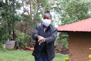 The Water Project: Malava Community, Ndevera Spring -  Trainer Masinde Taking The Group Through Handwashing