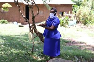 The Water Project: Shirugu Community, Shapaya Mavonga Spring -  Covid Trainer Karen Maruti Demonstrates Handwashing