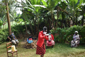 The Water Project: Ibinzo Community, Lucia Spring -  Demonstration Making Face Masks