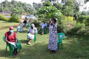 The Water Project: Shirakala Community, Ambani Spring -  One Member Addressing The Group About Masks