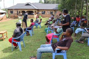 The Water Project: Elukuto Community, Isa Spring -  Issuing Handouts With Corona Virus To Community Members