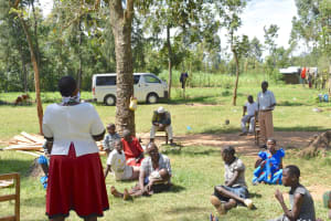 The Water Project: Munenga Community, Burudi Spring -  Community Member Expressing Some Concerns About The Virus