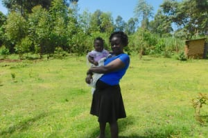The Water Project: Ataku Community, Ngache Spring -  Mother And Child Listening