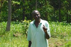 The Water Project: Sichinji Community, Kubai Spring -  Mr Kubai Reminds Everyone To Observe Curfew