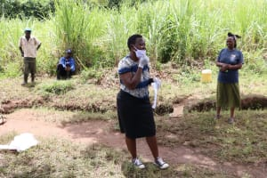 The Water Project: Shitoto Community, William Manga Spring -  Showing How To Adjust Face Mask