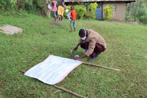The Water Project: Irungu Community, Irungu Spring -  Improvising A Stand At The Training