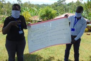 The Water Project: Visiru Community, Kitinga Spring -  Use Of Charts At The Training