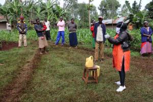 The Water Project: Wanzuma Community, Wanzuma Spring -  Proper Handwashing Demonstration