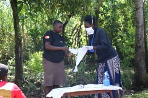 The Water Project: Chegulo Community, Yeni Spring -  Homemade Face Mask Demonstration