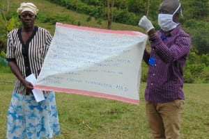 The Water Project: Ulagai Community, Rose Obare Spring -  Using Caution Chart At The Training