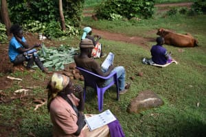 The Water Project: Ibinzo Community, Lucia Spring -  Following Training Using Pamphlets