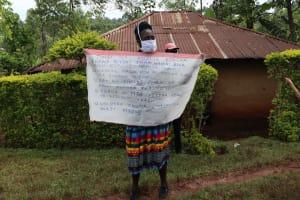 The Water Project: Wanzuma Community, Wanzuma Spring -  Use Of Caution Charts At The Training