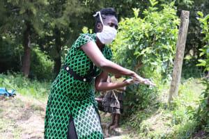 The Water Project: Ewamakhumbi Community, Yanga Spring -  Rub Your Palms Thoroughly