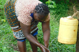 The Water Project: Mungakha Community, Nyanje Spring -  Rinsing Clean Hands