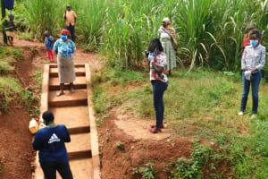 The Water Project: Emulembo Community, Gideon Spring -  Social Distancing At The Spring