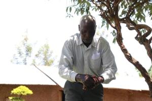 The Water Project: Shirugu Community, Shapaya Mavonga Spring -  Mr Shapaya Demonstrating Handwashing
