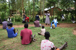 The Water Project: Musango Community, Emufutu Spring -  A Community Member Shows Her Homemade Mask