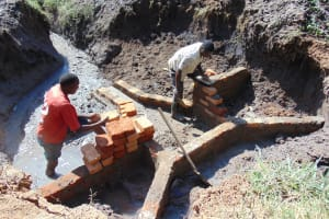 The Water Project: Shikangania Community, Abungana Spring -  Wall Construction