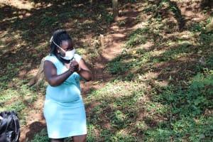 The Water Project: Irumbi Community, Okang'a Spring -  Facilitator Leads Handwashing Demonstration