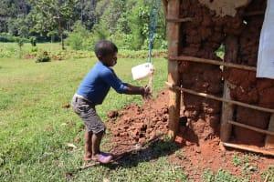 The Water Project: Irumbi Community, Shatsala Spring -  Child Washing Hands