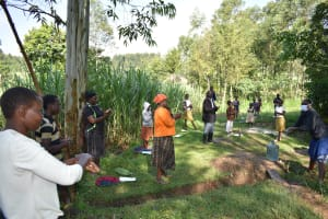 The Water Project: Bukhaywa Community, Ashikhanga Spring -  Community Members Follow The Ten Steps Of Handwashing