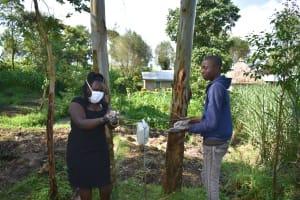 The Water Project: Bukhaywa Community, Ashikhanga Spring -  Handwashing With Soap And Running Water