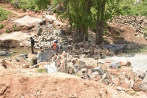 The Water Project: Kasioni Community B -  Large Rocks For Dam